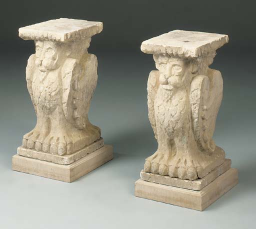 A pair of carved stone pedesta