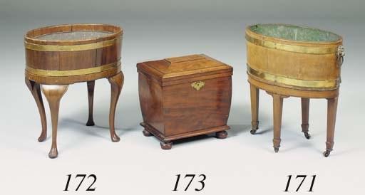 A mahogany oval cellarette, ea