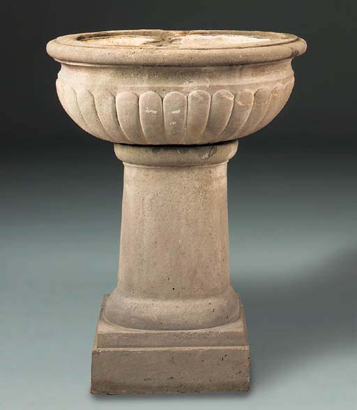 An Italian carved stone font a
