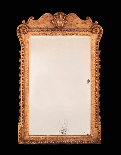 A carved giltwood mirror, earl