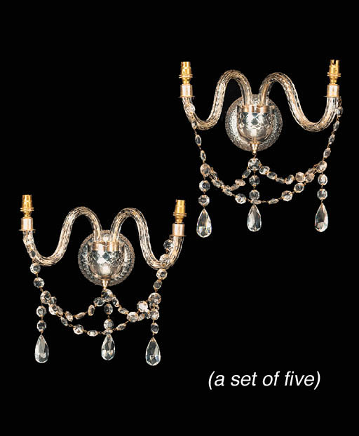 A set of four glass twin branc