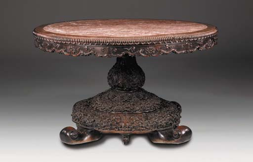 A Chinese carved hardwood marb