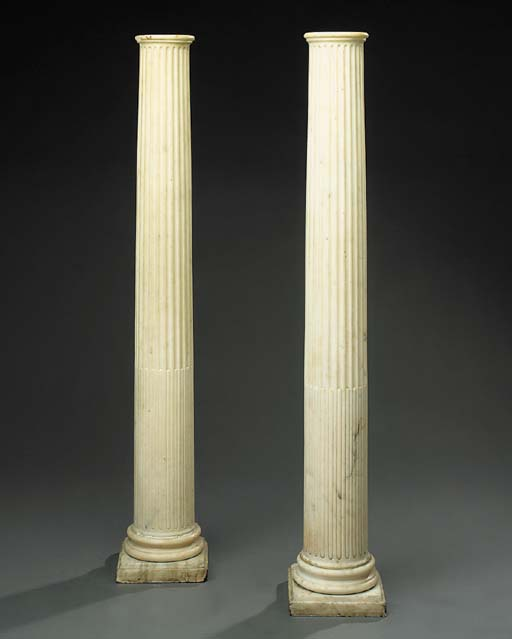 A pair of white marble archite