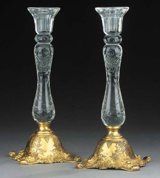 A pair of glass and gilt white