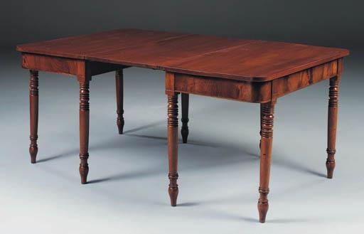 A mahogany extending dining ta