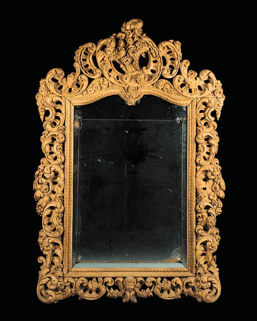 A carved oak wall mirror, late