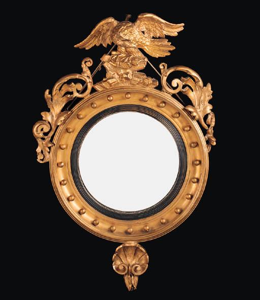 A giltwood convex mirror, late