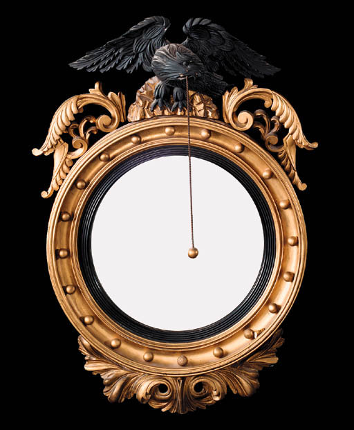 A giltwood convex mirror, 19th century