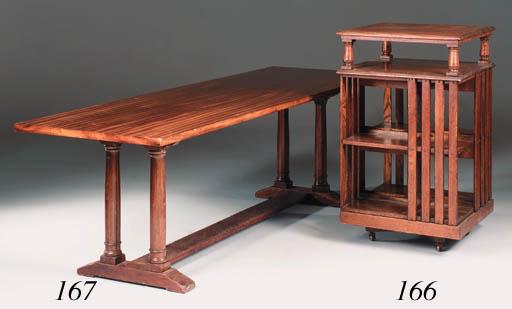 A large oak revolving bookcase