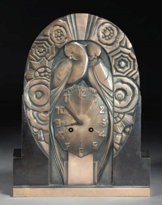 A PATINATED METAL CLOCK