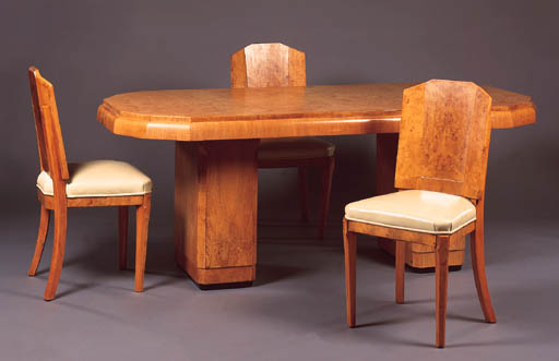 A BURR-ELM DINING SUITE