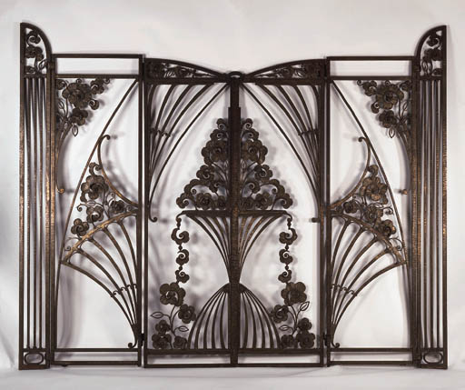 A PAIR OF WROUGHT IRON GATES