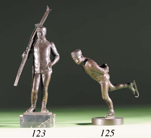 A COPPER FIGURE OF A SKIER