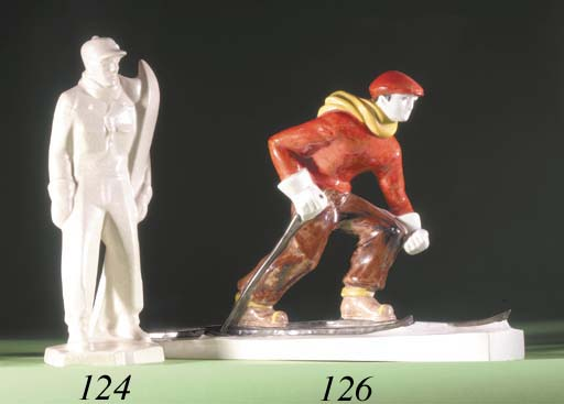 A CRAQUELURE POTTERY FIGURE