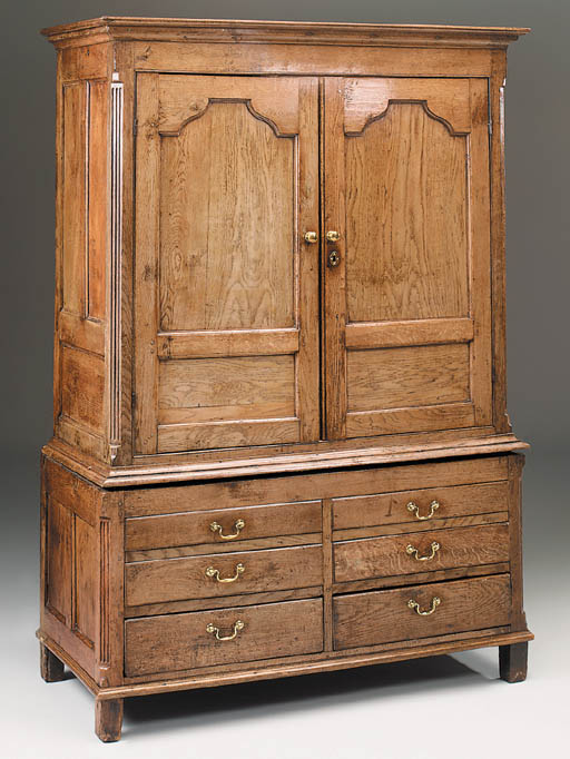 An oak press cupboard, English