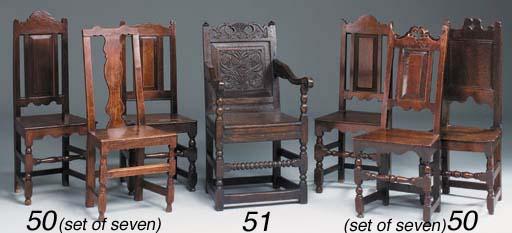 An oak panel back armchair, La