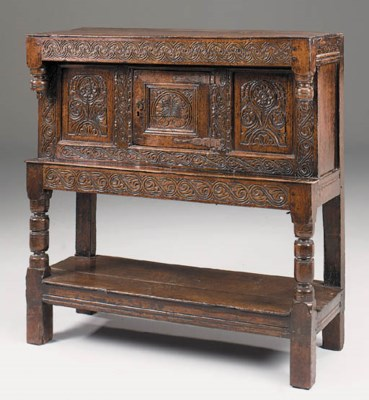 A carved oak livery cupboard,