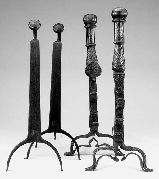 Two pairs of cast iron andiron