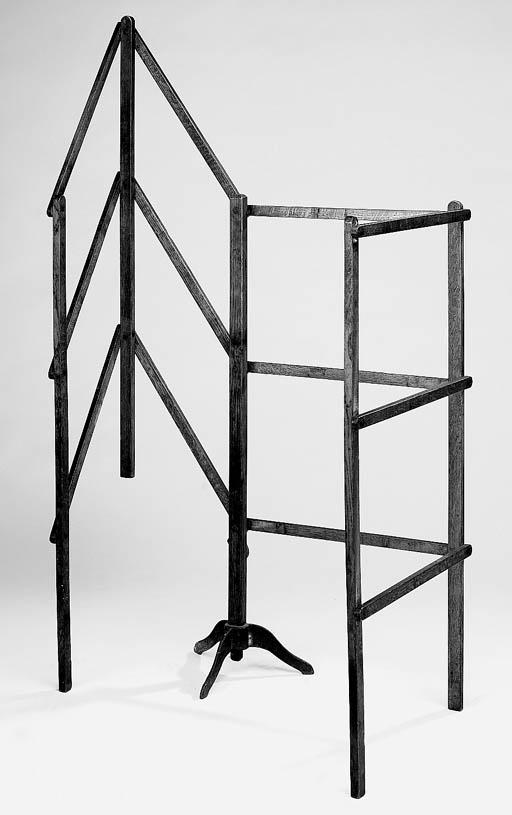 A folding wood towel rail, 19t