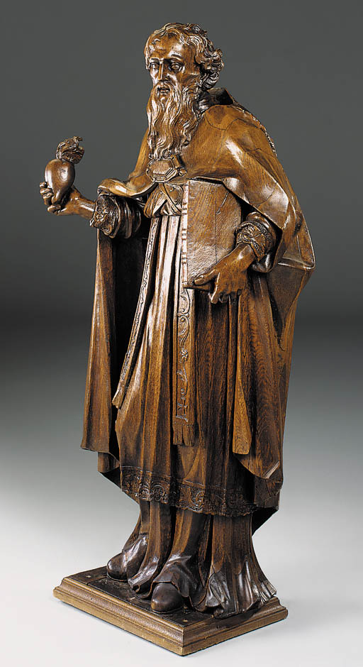 AN ENGLISH OAK CARVING OF ST A