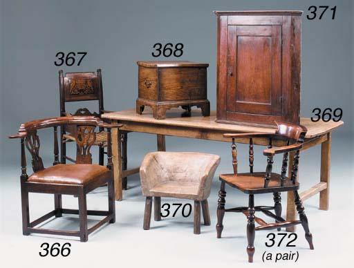 An oak corner armchair, Englis