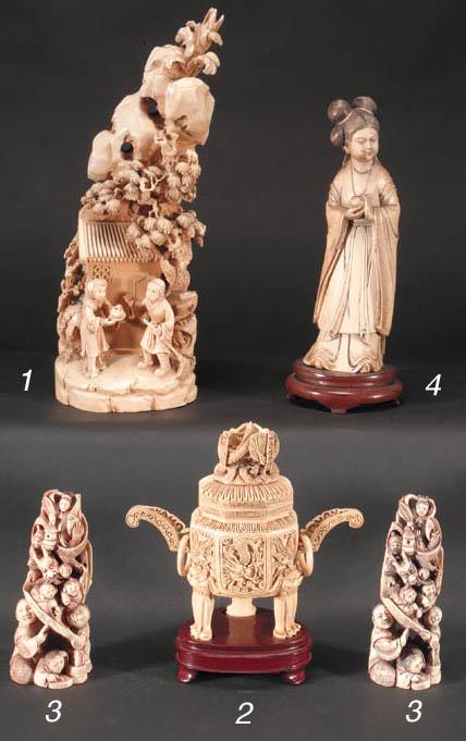 A pair of ivory okimono 20th C