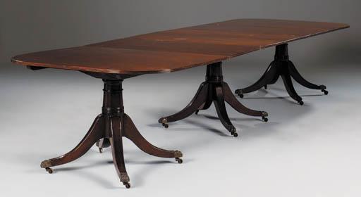 A mahogany tripod pedestal din
