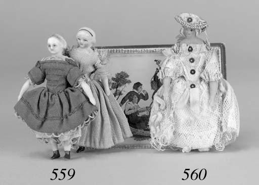 A wax-headed dolls' house doll