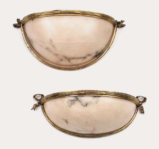 A pair of alabaster and gilt b