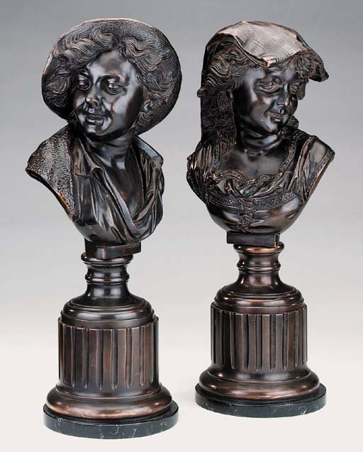 A pair of bronze busts of chil