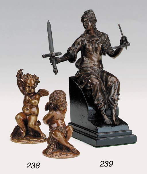 A pair of French bronze cherub