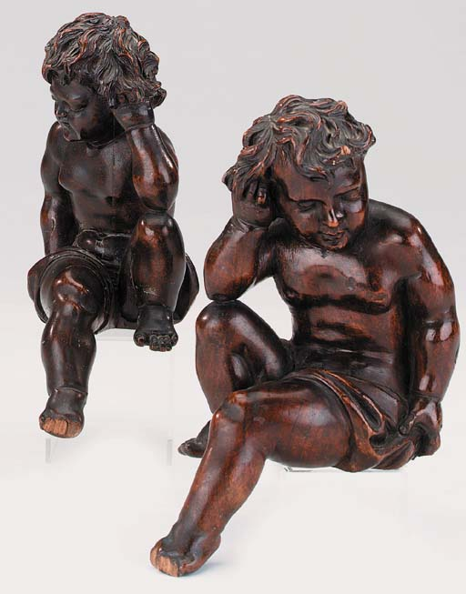A pair of carved walnut figure