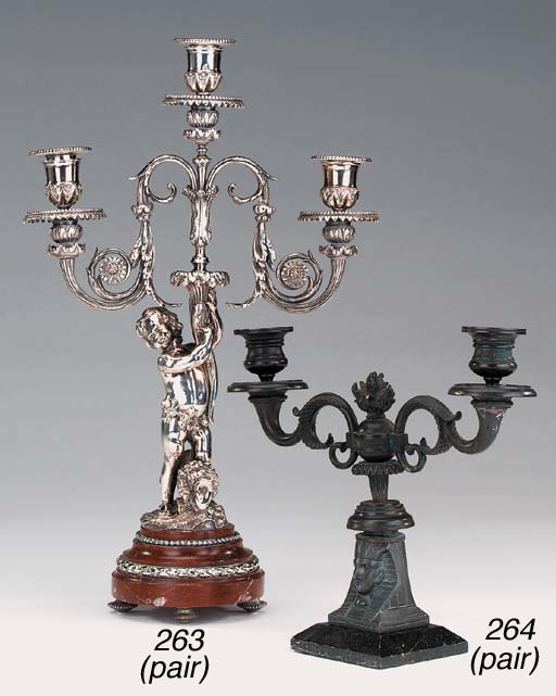 A pair of bronze and spelter m
