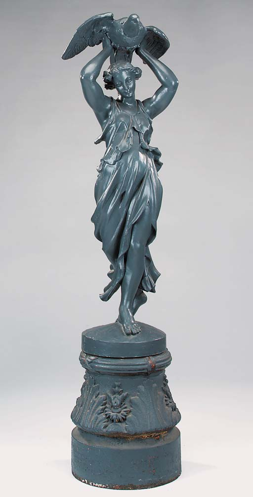 A cast iron figure of a maiden