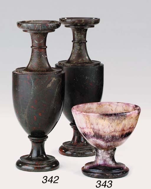 A pair of serpentine marble va