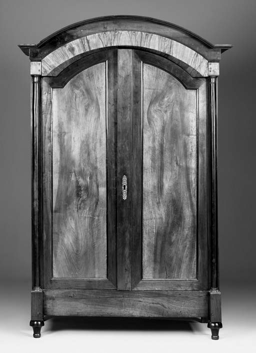 A walnut and fruitwood armoire