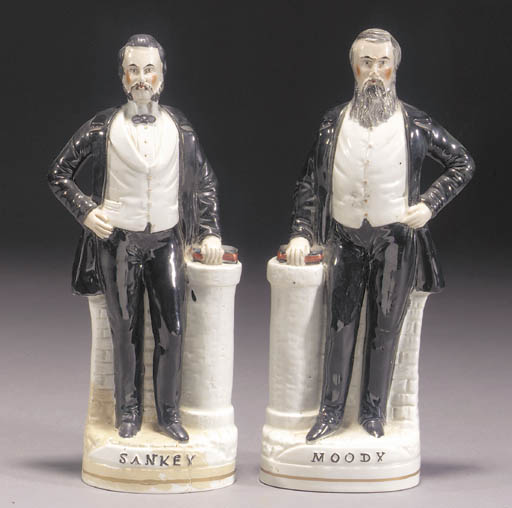 A pair of figures of Moody and