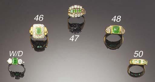 A cabochon emerald and triangu