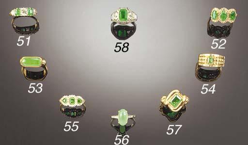 An emerald and diamond triple