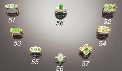 An emerald single stone ring b