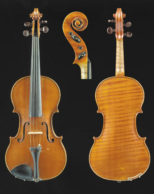 A good modern Italian violin by Riccardo Antoniazzi, labelled Antoniazzi Riccardo di Cremona figlio di Gaetano fece in Milano/l'anno 1912 and signed on the label; the one-piece back of medium curl, the varnish of an orange colour, the length of back 14 1/8in (359mm), with case and bow stamped G. Ullmann Milan