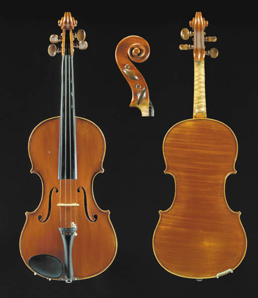 A good modern Italian violin by Oreste Candi, Genoa 1930, labelled N. 107 Oreste Candi Fece in Genova/l'anno 1930, and branded internally Oreste Candi Genova; the one-piece back of light narrow curl, the varnish of a red colour, length of back 14 1/8in (357mm), with case