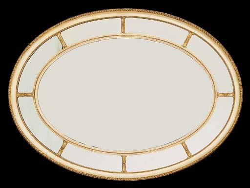 An Edwardian giltwood and cream painted oval wall mirror