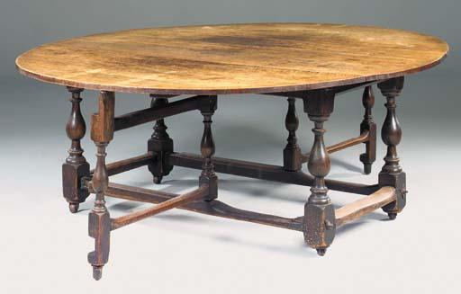 A large Dutch oak gateleg dining table, 19th century