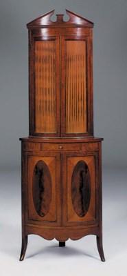 An Edwardian mahogany bowfront