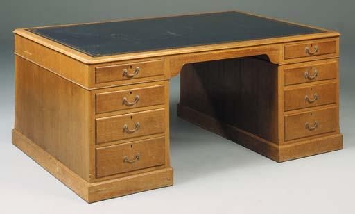 An oak pedestal desk, 20th cen