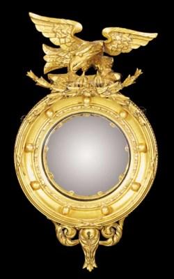 A giltwood convex mirror, 19th