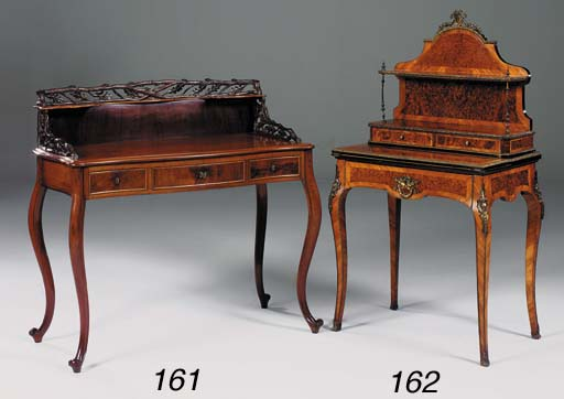 A German mahogany serpentine fronted desk/dressing table, late 19th century