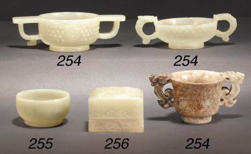 A celadon jade two handled cup