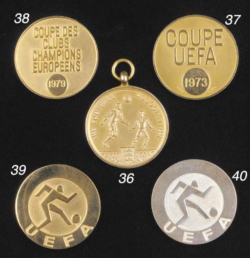 A yellow metal UEFA Cup Winner
